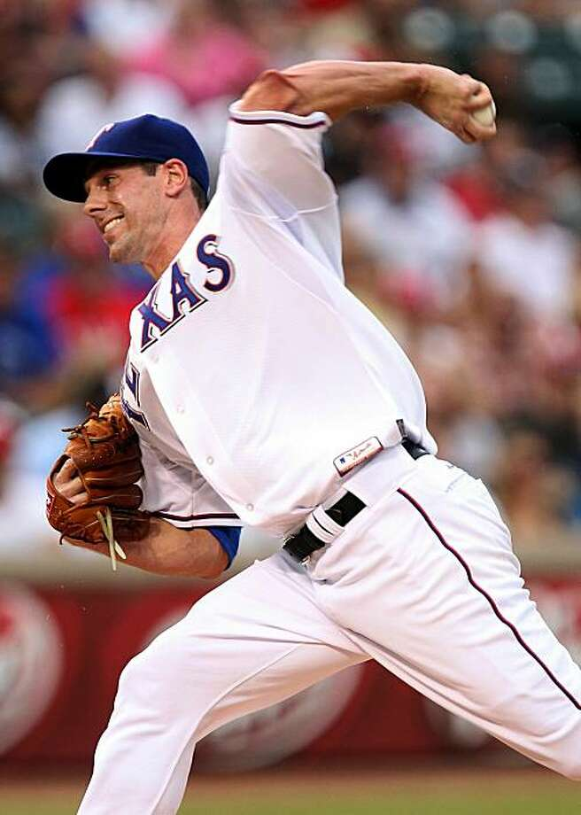 ARLINGTON, TX - JULY 10:  Pitcher Cliff Lee #33 of the Texas Rangers throws against the Baltimore Orioles on July 10, 2010 at Rangers Ballpark in Arlington, Texas. Photo: Ronald Martinez, Getty Images