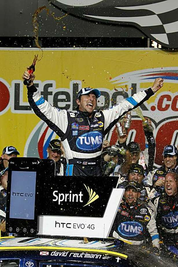 JOLIET, IL - JULY 10:  David Reutimann, driver of the #00 TUMS Toyota, celebrates in victory lane after he won the NASCAR Sprint Cup Series LIFELOCK.COM 400 at the Chicagoland Speedway on July 10, 2010 in Joliet, Illinois.  (Photo by Chris Trotman/Getty Images for NASCAR) Photo: Chris Trotman, Getty Images For NASCAR