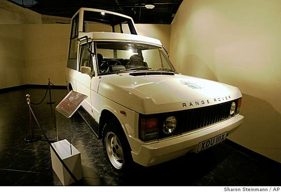 ** ADVANCE FOR WEEKEND, NOV. 27-30 ** A Popemobile is shown in an exhibit at the  National Museum of Funeral History on Tuesday, Nov. 11, 2008, in Houston. This 1982 Range Rover was specially created for Pope John Paul's II visit to Great Britain in 1982.The National Museum of Funeral History will open the only permanent exhibit of Papal artifacts outside of the Vatican on Nov. 25. ( AP Photo/ Houston Chronicle, Sharon Steinmann) Photo: Sharon Steinmann, AP