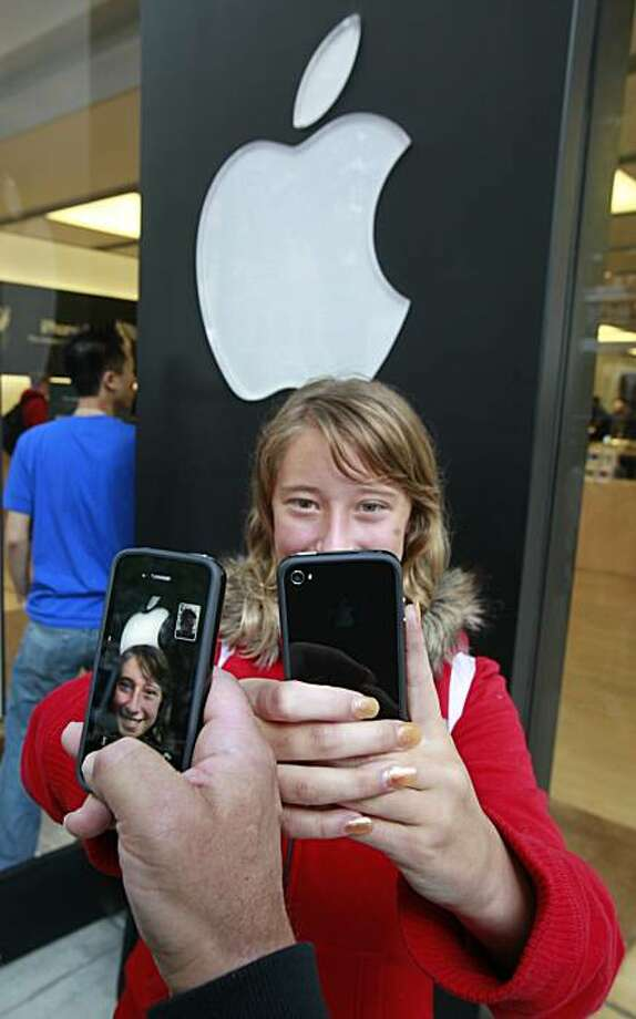 Emilie Weideman and her father, Marc Weideman, of Fremont, Calif., uses the new Apple iPhone 4 program FaceTime after purchasing the new device, Thursday, June 24, 2010, at an Apple Store in Palo Alto, Calif. FaceTime allows face-to-face video calls between phones. Photo: Paul Sakuma, AP