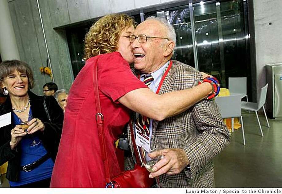 Chronicle science reporter David Perlman gets a hug from his friend Ashley Wolff during his 90th birthday party at the California Academy of Sciences in San Francisco, Calif., on Monday, December 01, 2008. Photo: Laura Morton, Special To The Chronicle