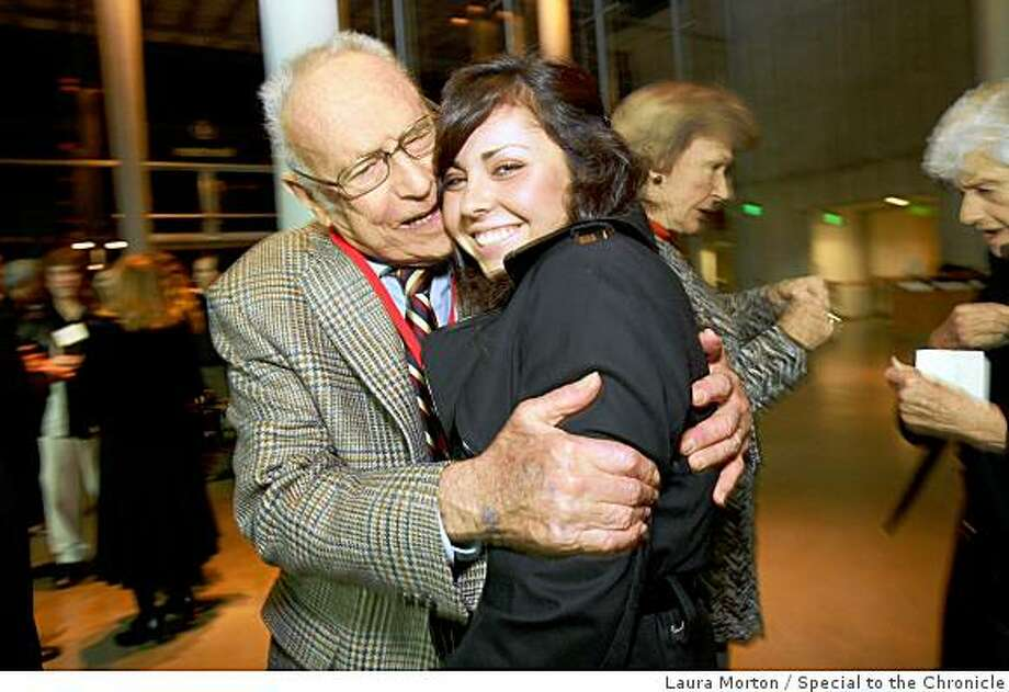 Chronicle science reporter David Perlman gives a hug to his granddaughter Kyriana Perlman during his 90th birthday party at the California Academy of Sciences in San Francisco, Calif., on Monday, December 01, 2008. Photo: Laura Morton, Special To The Chronicle