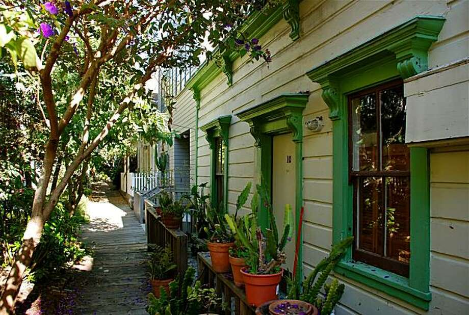 Picturesque Napier Lane, which is located just off the Filbert Steps on Telegraph Hill, is a small walking street that leads to a few mid-1900 homes surrounded by lush gardens and a plank walking path. There are only a dozen or so homes, which add to the quaint feel of the lane. Photo:  Tom Graham