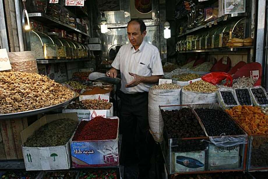 In this picture taken on Monday, Sept. 1, 2008, a shopkeeper works at his shop, at the Tehran's old main bazaar. A wave of anti-tax strikes _ with Tehran's expansive bazaar as the epicenter _ has brought another potential jam for Iranian leaders still trying to weigh the fallout from wider U.N. and American sanctions. Photo: Vahid Salemi, Associated Press 2008