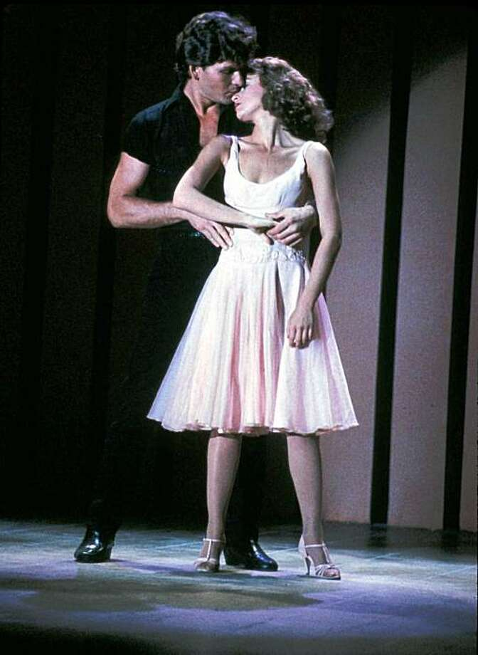 "In this image provided by Lionsgate Home Entertainment, Patrick Swayze, portraying Johnny Castle, and Jennifer Grey, portraying Baby Houseman, are shown in a scene from the film ""Dirty Dancing."" Swayze's publicist Annett Wolf says the 57-year-old ""Dirty Dancing"" actor died Monday, Sept. 14, 2009, after a nearly two-year battle with pancreatic cancer. Photo: Lionsgate Home Entertainment, AP"