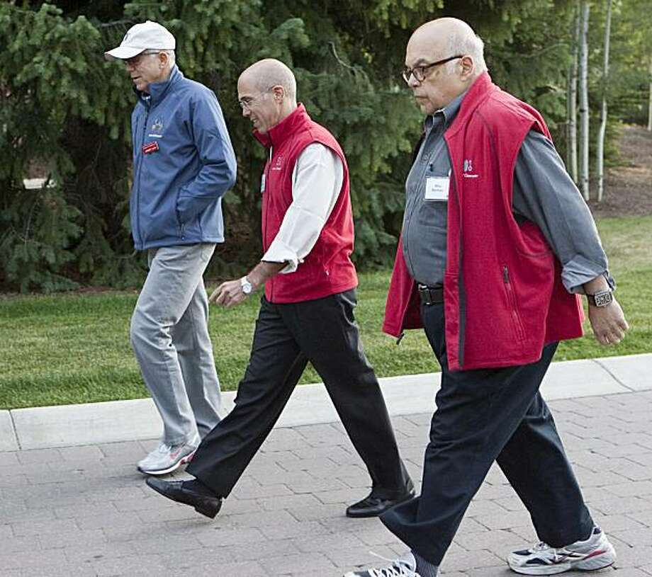Herb Allen of Allen & Company, left,  Jeffrey Katzenberg of Dreamworks Animation, and Mike Berman, right, of the Duberstein Group, walk to a morning session at the annual Allen & Co. Media summit in Sun Valley, Idaho, Friday, July 9, 2010. Photo: Nati Harnik, AP