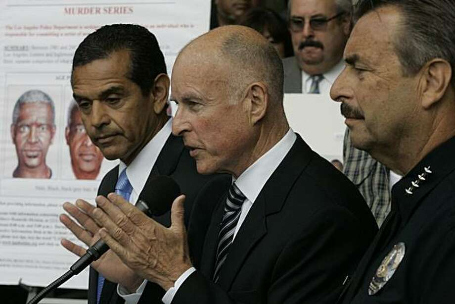 Los Angeles Mayor Antonio Villaraigosa, from left, Attorney General Jerry Brown and LAPD Police Chief Charlie Beck speak to reporters Thursday, July 8, 2010, during a news conference held outside the Police Administration Building in downtown Los Angeles announcing the arrest of Lonnie David Franklin, Jr. on suspicion of carrying out the Grim Sleeper serial killings over the past 25 years. (Gary Friedman/Los Angeles Times/MCT) Photo: Gary Friedman, MCT