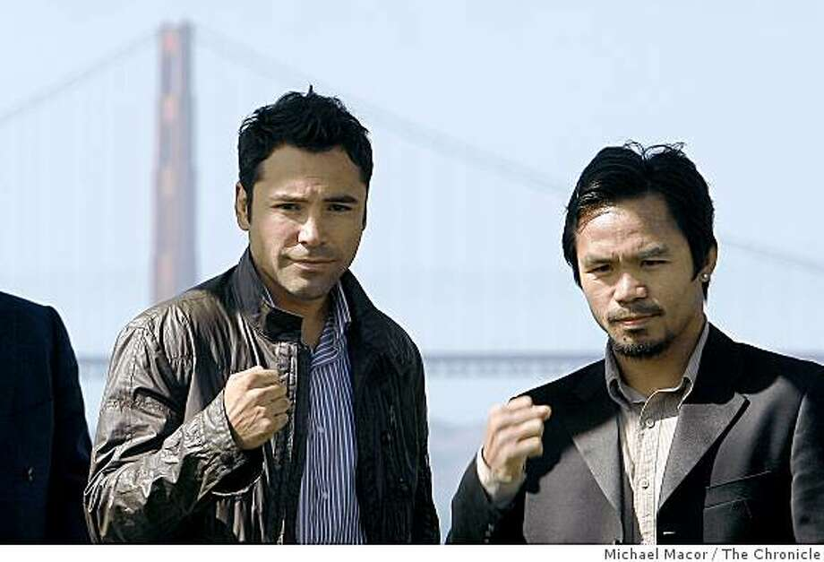 Boxers, Oscar De la Hoya, (left) and Manny Pacquiao attend a press coference and rally at the Great Meadow at Fort Mason in San Francisco, Calif. on Saturday Oct. 4, 2004 to promote their upcoming fight in Las Vegas on Dec. 6. Photo: Michael Macor, The Chronicle