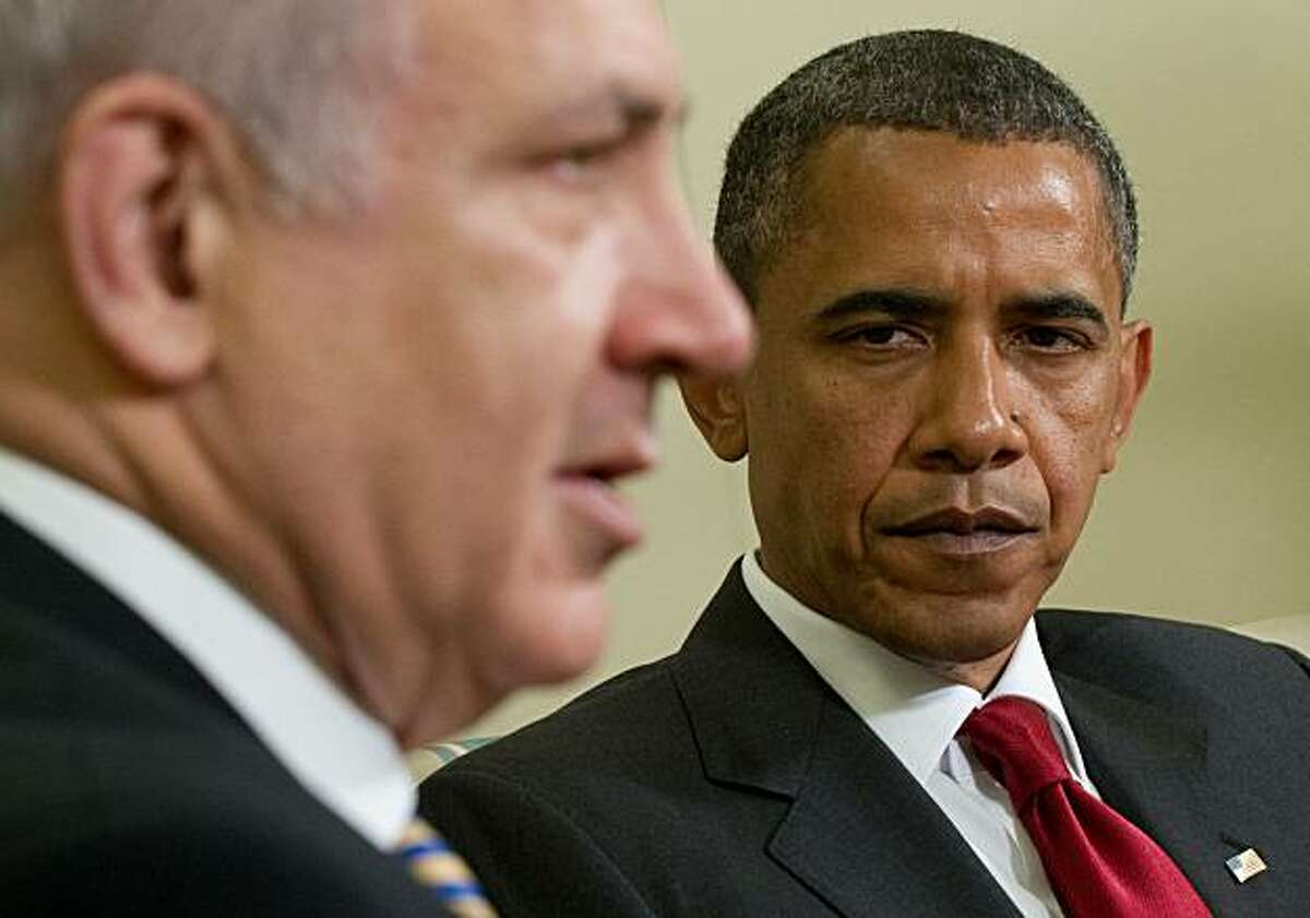 US President Barack Obama listens to Israel's Prime Minister Benjamin Netanyahu during meetings in the Oval Office of the White House in Washington on July 6, 2010.