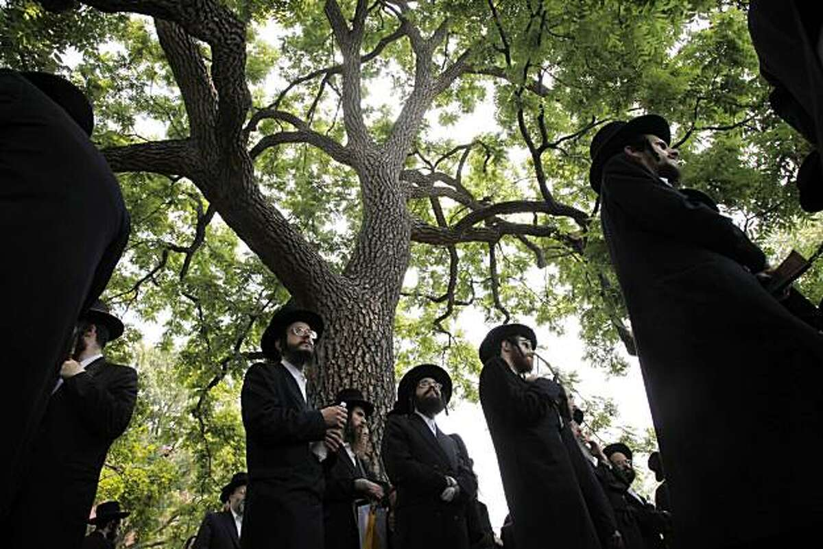 Jewish protesters gather in Lafayette Park across from the White House in Washington, Tuesday, July 6, 2010, as President Barack Obama met with Israeli Prime Minister Benjamin Netanyahu.