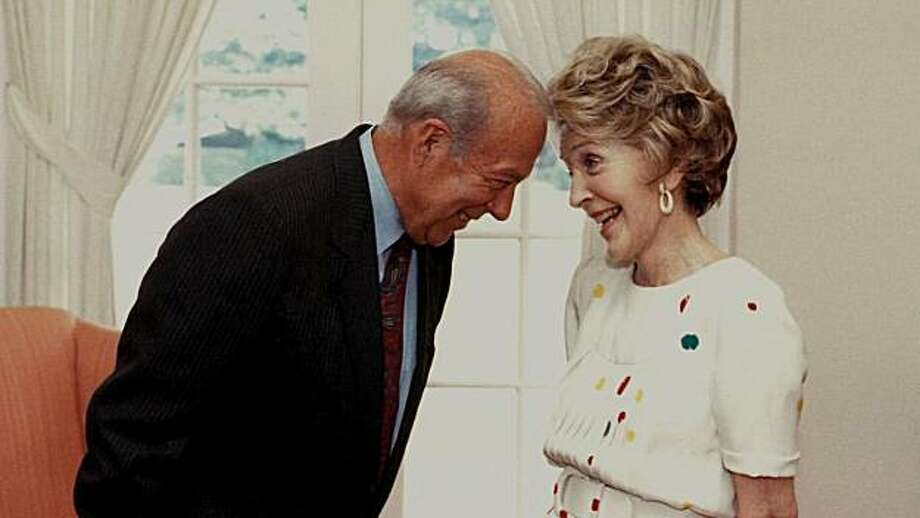 TURMOIL & TRIUMPH: THE GEORGE SHULTZ YEARS  George Shultz with First Lady Nancy Reagan. Photo: Hoover Institution