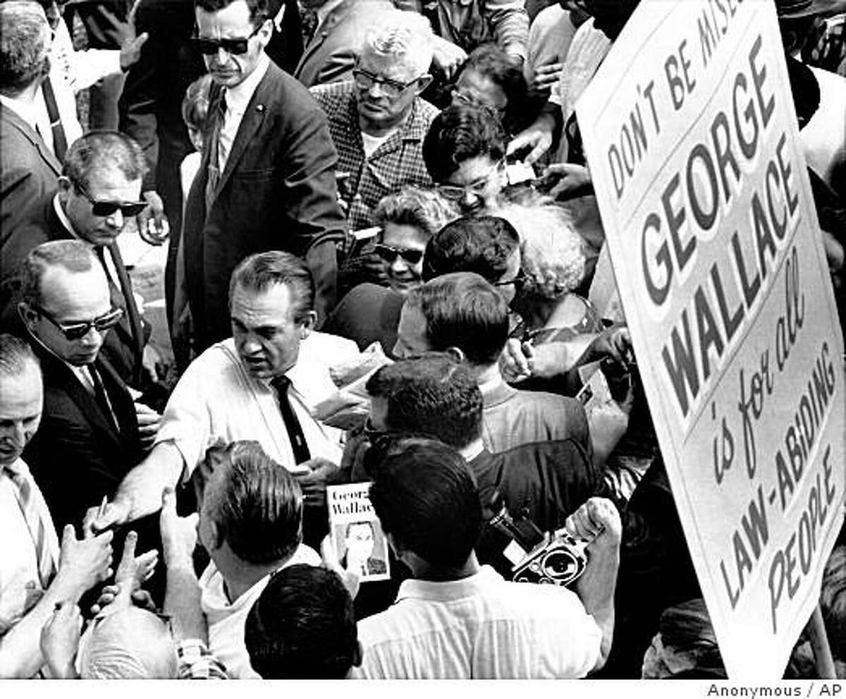 ** FILE ** In this July, 13, 1968, file photo U.S. Presidential Candidate George Wallace campaigns in Glen Burnie, Md. In Nixon-era documents, newly released Tuesday, Dec. 2, 2008, Alabama Gov. George Wallace was branded a