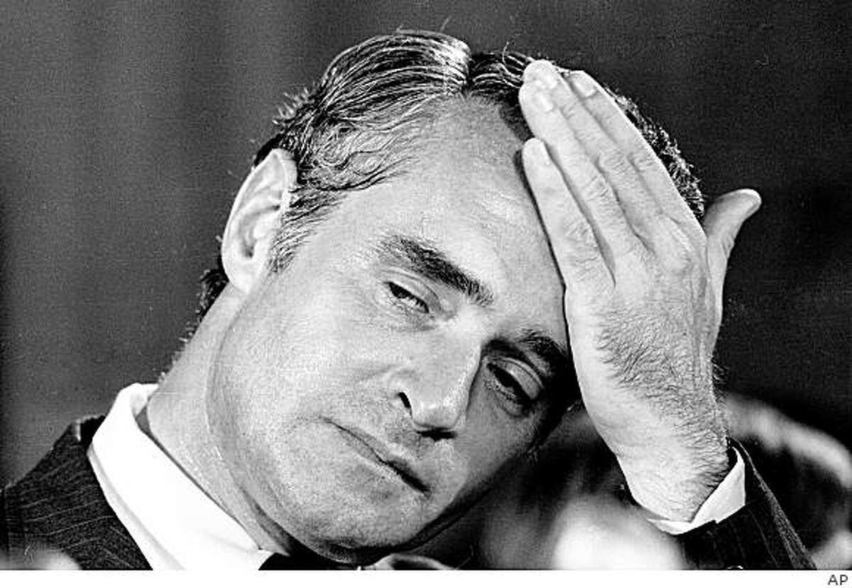 ** FILE ** In this Aug. 1, 1972, file photo Sen. Thomas Eagleton reacts while listening to presidential hopeful Sen. George McGovern's announcement that Eagleton is stepping aside as his vice-presidential running mate during a news conference in Washington. Newly released Nixon-era documents show Eagleton's treatments for mental illness were reported to Nixon's secretary before that disclosure forced him to resign from the 1972 Democratic ticket. (AP Photo)