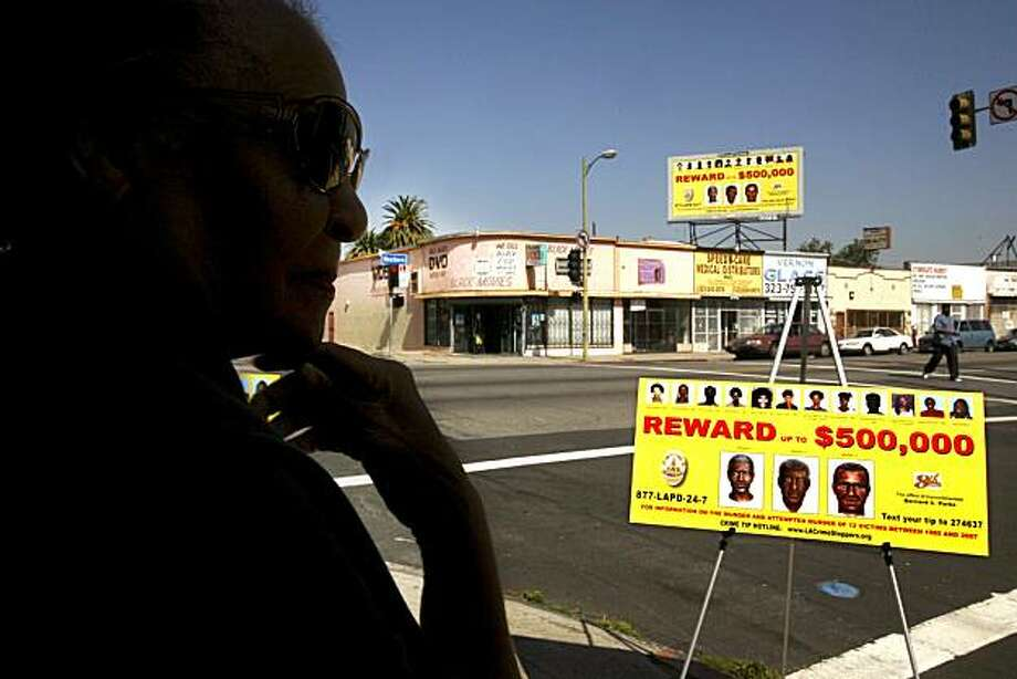 """Mary Taylor gazes at a wanted poster for the serial killer known as the """"Grim Sleeper"""" in Los Angeles, California on May 4, 2010. (Los Angeles Times/MCT) Photo: Los Angeles Times, MCT"""