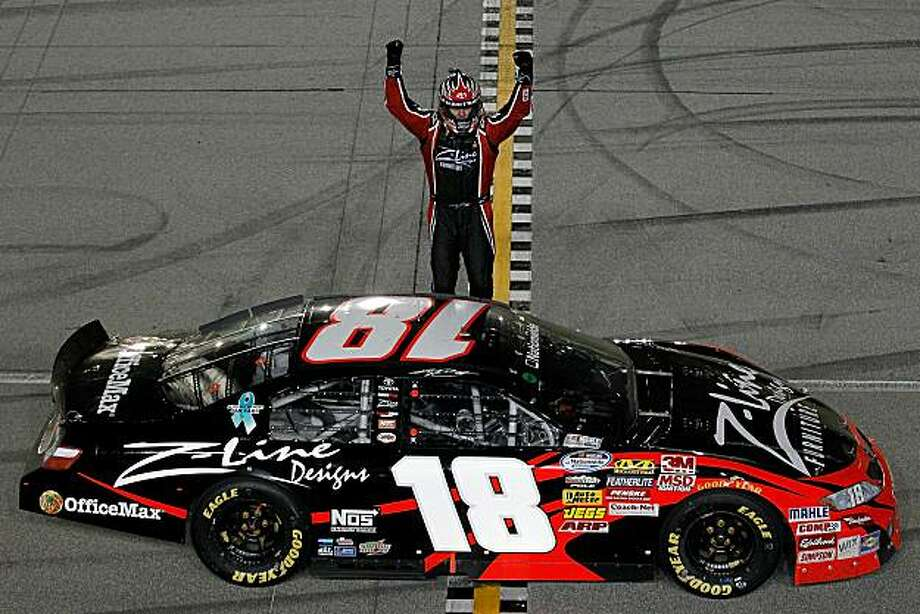 JOLIET, IL - JULY 09:  Kyle Busch, driver of the #18 Z-Line Designs Toyota, celebrates after he won the NASCAR Nationwide Series Dollar General 300 Powered by Coca-Cola at the Chicagoland Speedway on July 9, 2010 in Joliet, Illinois.  (Photo by Todd Warshaw/Getty Images for NASCAR) Photo: Todd Warshaw, Getty Images For NASCAR