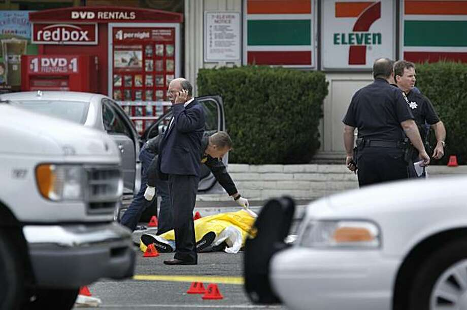 Investigators on the scene, after an armed man was shot and killed by law-enforcement officers in San Ramon, Ca., early today, on Thursday July 8, 2010, after he stormed into a convenience store, spent more than an hour inside drinking alcohol, then pointed his gun at police after taking one last swig of beer, authorities said. Photo: Michael Macor, The Chronicle