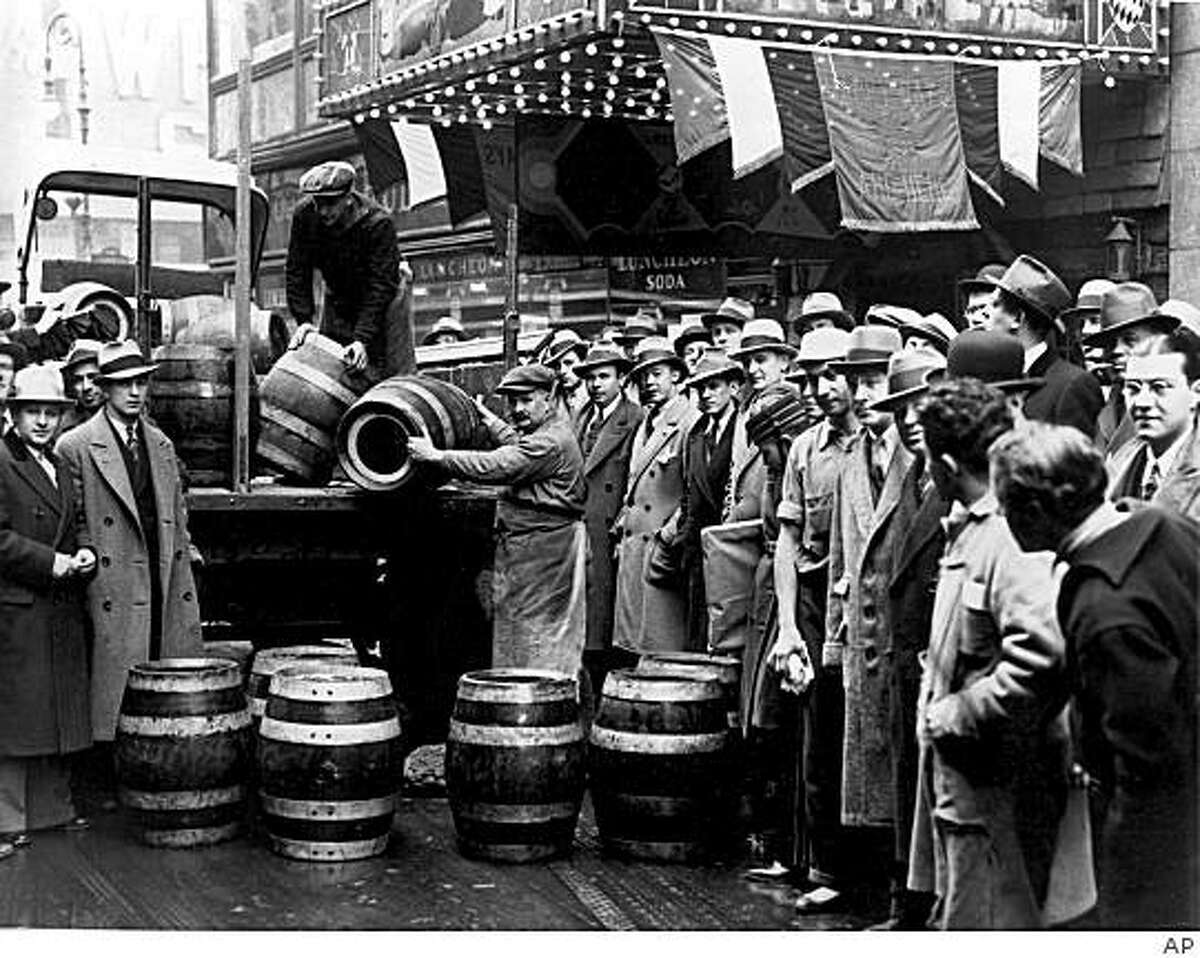 A crowd gathers as kegs of beer are unloaded in front of a restaurant on Broadway in New York City, the morning of April 7, 1933, when low-alcohol beer is legalized again.