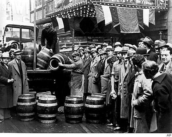 A crowd gathers as kegs of beer are unloaded in front of a restaurant on Broadway in New York City, the morning of April 7, 1933, when low-alcohol beer is legalized again. Photo: AP