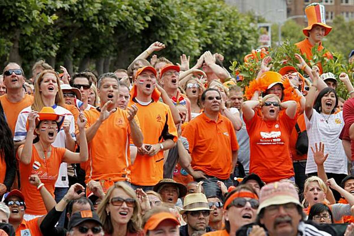 Fans of the Netherlands, in orange, react to a missed scoring opportunity in the second half. Thousands of soccer fans gathered in City Hall Plaza in San Francisco to watch the World Cup final Sunday.