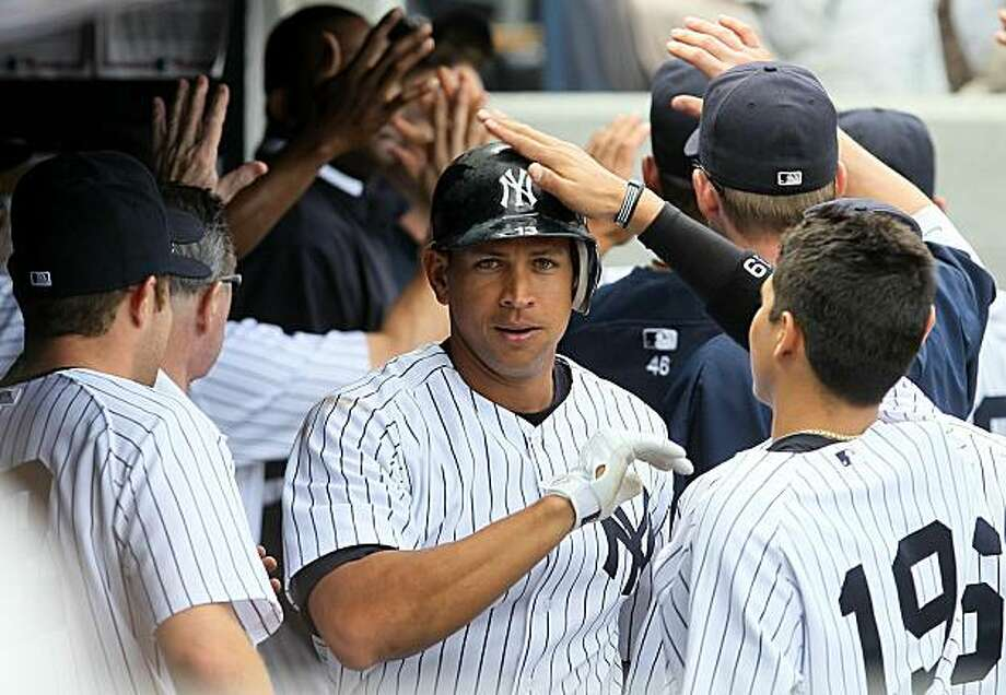 NEW YORK - JULY 01:  Alex Rodriguez #13 of the New York Yankees celebrates his eigth inning two run home run against the Seattle Mariners on July 1, 2010 at Yankee Stadium in the Bronx borough of New York City. The Yankees defeated the Mariners 4-2. Photo: Jim McIsaac, Getty Images