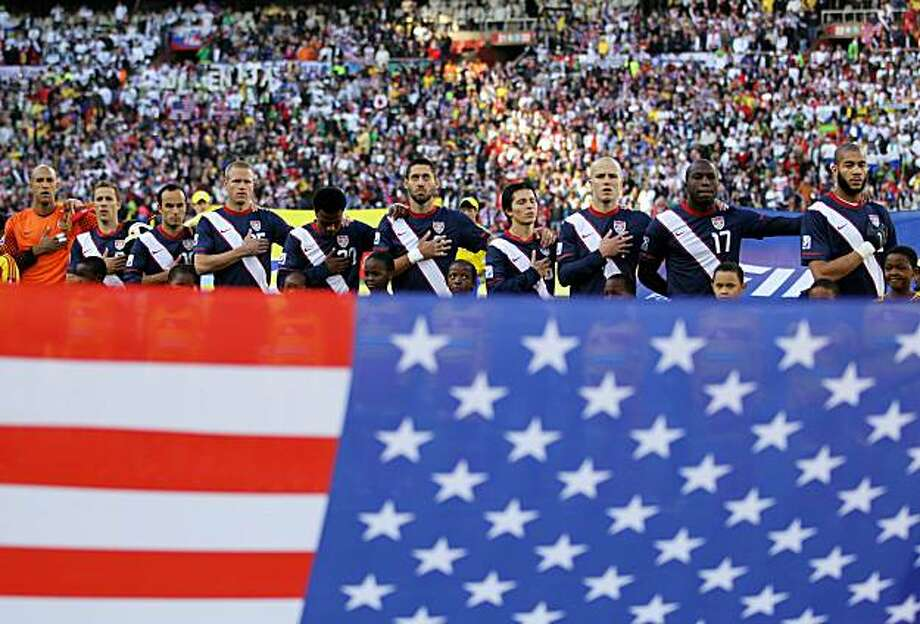 JOHANNESBURG, SOUTH AFRICA - JUNE 18:  The United States team line up and sing their national anthem ahead of the 2010 FIFA World Cup South Africa Group C match between Slovenia and USA at Ellis Park Stadium on June 18, 2010 in Johannesburg, South Africa. Photo: Ezra Shaw, Getty Images