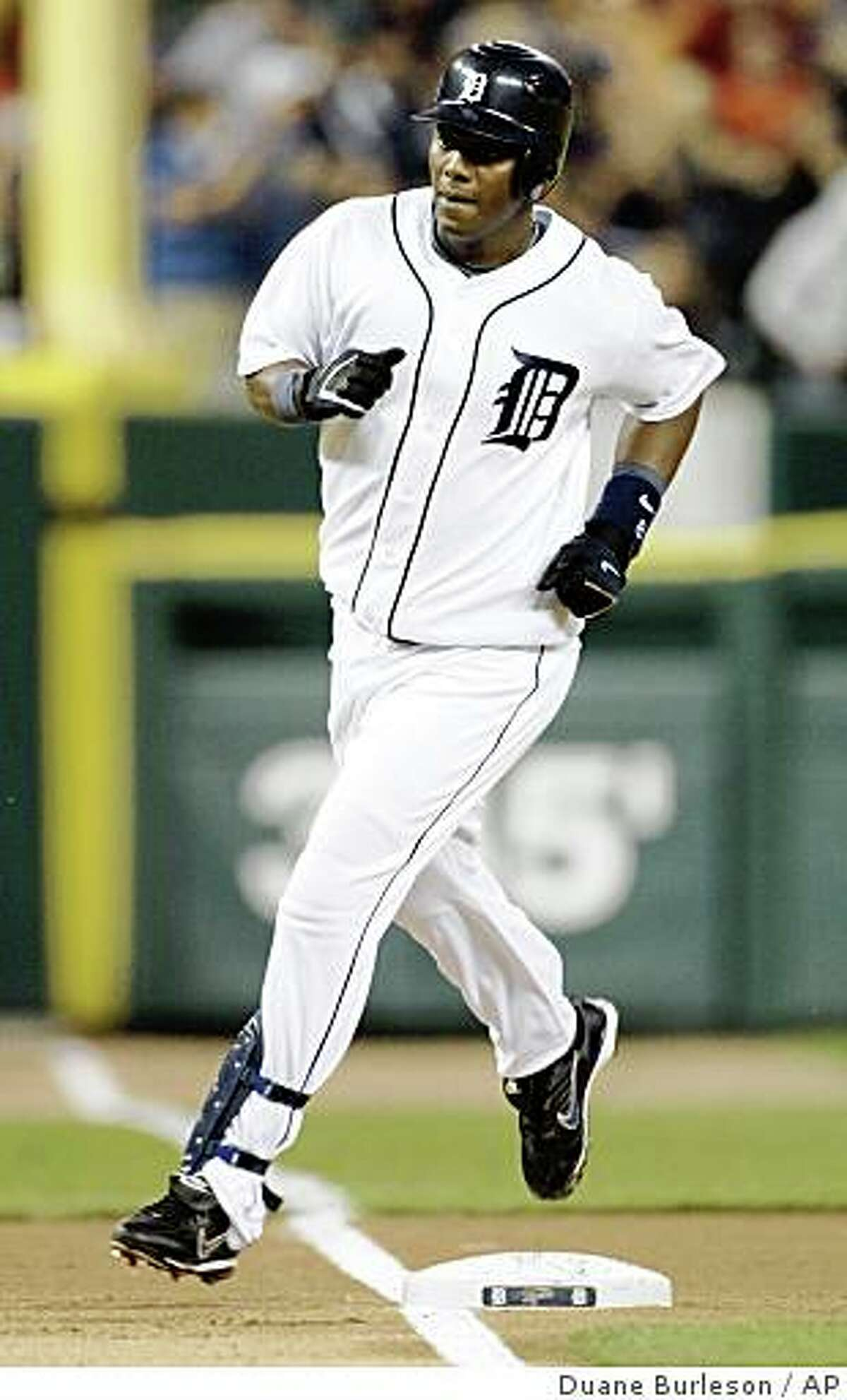 Detroit Tigers' Edgar Renteria rounds the bases after hitting a solo home run off Oakland Athletics starter Dan Meyer in the third inning of a baseball game Saturday, Aug. 9, 2008, in Detroit.