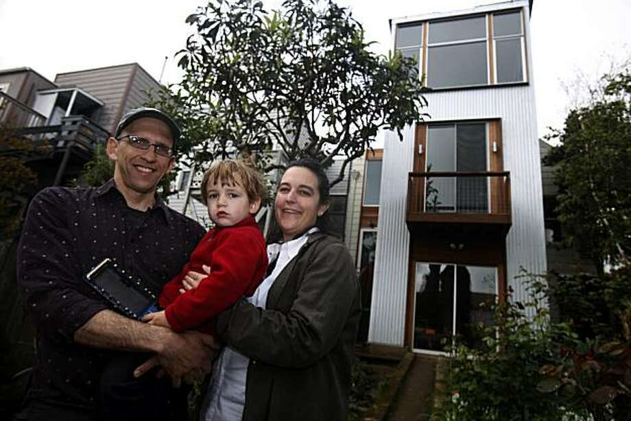 Jon Chester (l to r), Chester Bliss and Sharon Bliss are seen in front of their three story addition in San Francisco, Calif. on Thursday March 25, 2010. Photo: Lea Suzuki, The Chronicle
