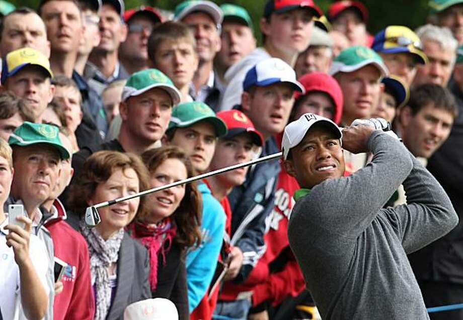 Tiger Woods plays his second shot on the 2nd hole during the JP McManus Invitational Pro-Am at Adare Manor, Limerick, Ireland, Tuesday, July 6, 2010. Photo: Peter Morrison, AP