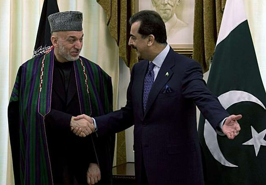 n this March 11, 2010 file photo, Pakistan's Prime Minister Yousuf Raza Gilani, right, welcomes Afghanistan's President Hamid Karzai for bilateral talks at the prime minister's official residence and office, in Islamabad, Pakistan. Photo: B.K.Bangash, AP