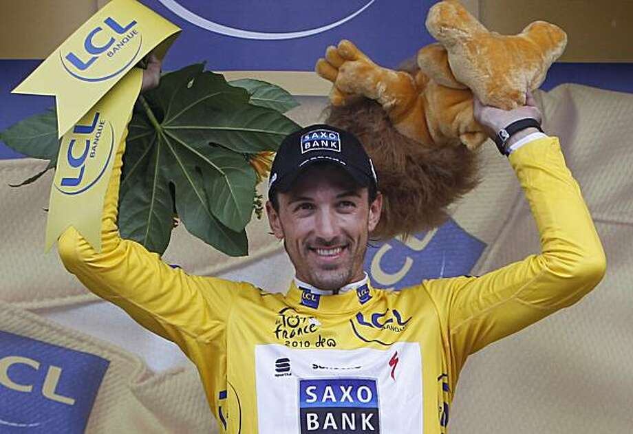 Fabian Cancellara of Switzerland, wearing the overall leader's yellow jersey, reacts on the podium after winning the prologue of the Tour de France cycling race, an individual time trial over 8,9 kilometers (5.5 miles) in the port city of Rotterdam, Netherlands,  Saturday July 3, 2010. Photo: Christophe Ena, AP