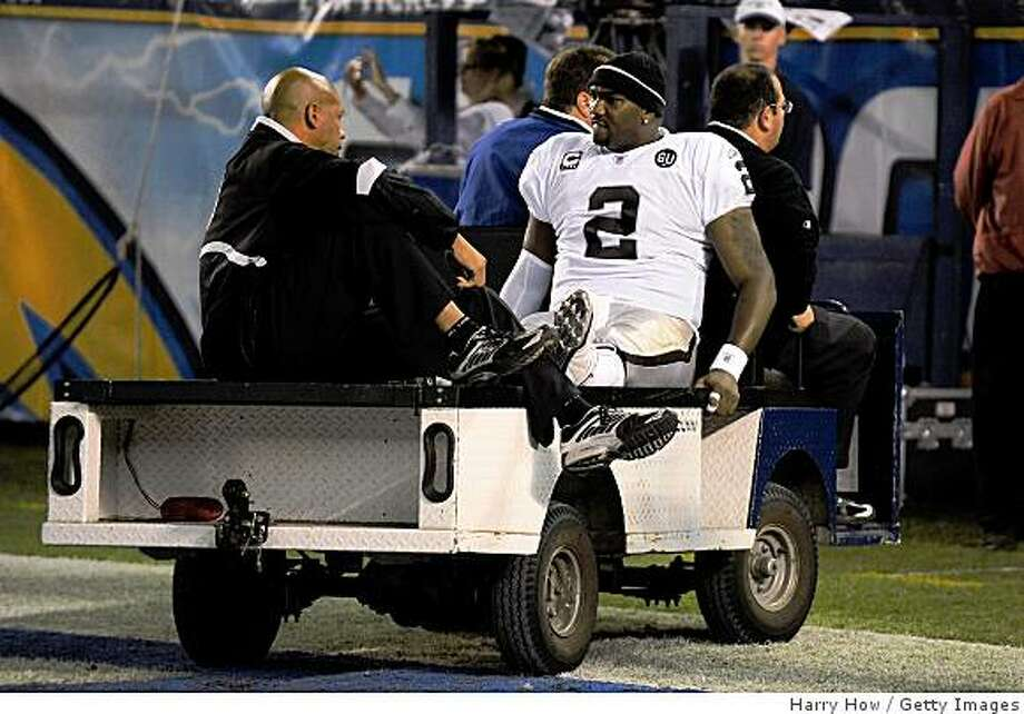 Raiders quarterback JaMarcus Russell is taken off the field on a cart after being injured during a game against the San Diego Chargers on December 4, 2008 at Qualcomm Stadium in San Diego, California. Photo: Harry How, Getty Images