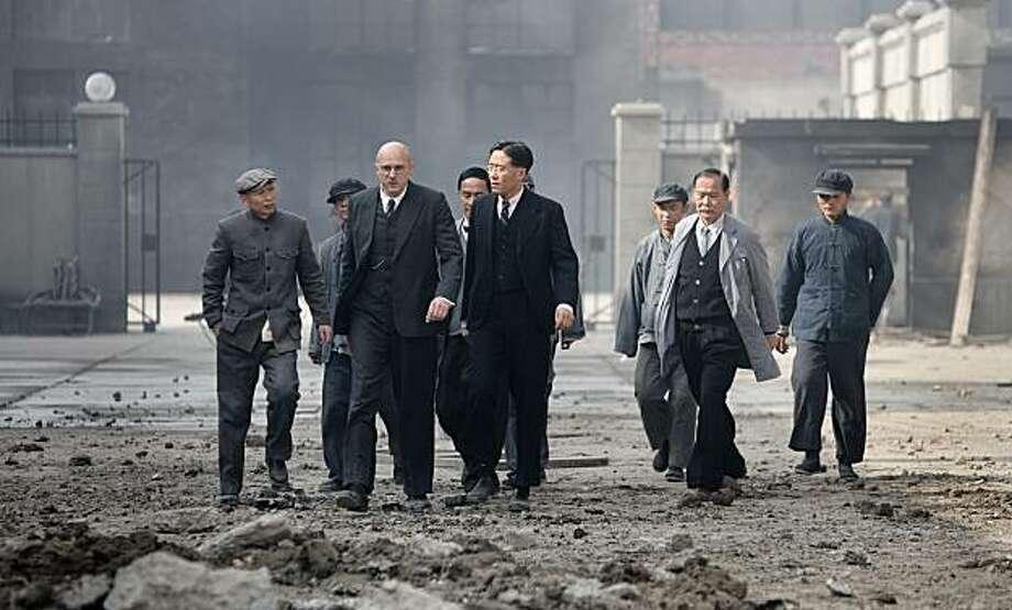 "Ming Li, Ulrich Tukur, Fang Yu in ""John Rabe."" Photo: Strand Releasing"
