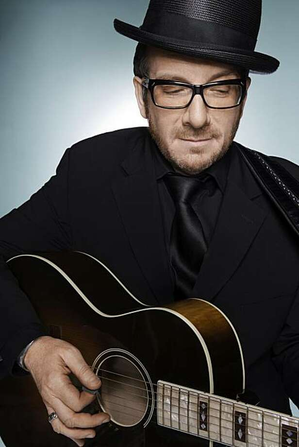 """In this image released by the Sundance Channel, Elvis Costello, host of the Sundance Channel original series, """"Spectacle,"""" is shown.  The program premieres on Dec. 3 at 9:00 p.m. EDT. Photo: Sundance Channel, AP"""