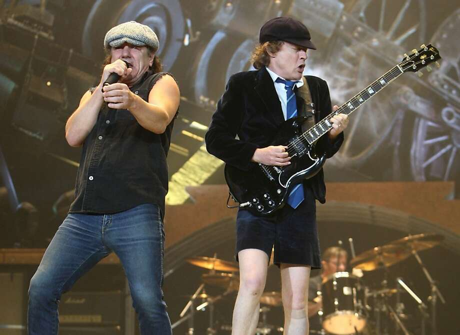 Brian Johnson (l to r) and Angus Young  of AC/DC perform with AC/DC at the Oracle Arena in Oakland, Calif. on Tuesday, December 2, 2008.   Phil Rudd (on drums) plays in the background. Photo: Lea Suzuki, The Chronicle