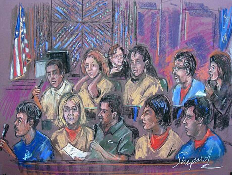 This courtroom drawing shows the ten alleged spy suspects in a New York courtroom on July 8, 2010. Russia has agreed to release four people accused of working for Western intelligence agencies in return for 10 spies who pled guilty Thursday in a US court,the Justice Department said. Under the deal hammered out with Moscow, the 10 agents rounded up last week in an FBI swoop all pled guilty to being foreign agents and were ordered by the judge in a New York court to be immediately deported. Photo: Shirley Shepard, AFP/Getty Images