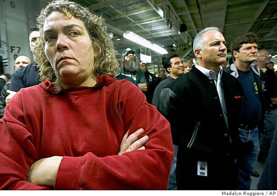 Amy Vollmar, 43, from Bowling Green, Ohio, a worker for Chrysler for the past 24 years, listens during a Chrysler rally at the Jeep plant in Toledo, Ohio, Wednesday, Dec. 3, 2008.    (AP Photo/Madalyn Ruggiero) Photo: Madalyn Ruggiero, AP