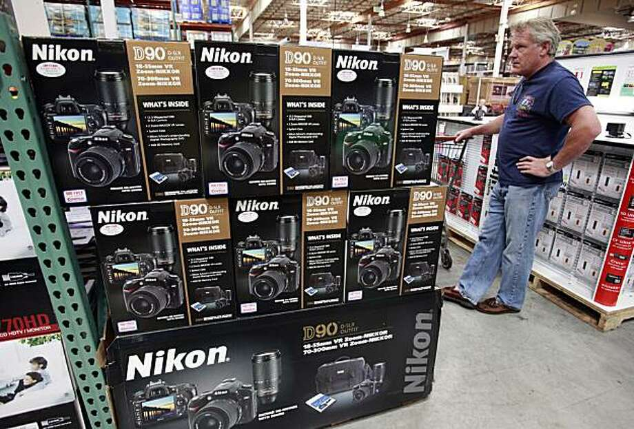 Costco customer looks at a Nikon camera at Costco in Mountain View, Calif., Wednesday, July 7, 2010. Inventories held by wholesalers rose for a fifth consecutive month in May but sales fell for the first time in more than a year, sending a mixed signal about the strength of the recovery. Photo: Paul Sakuma, AP