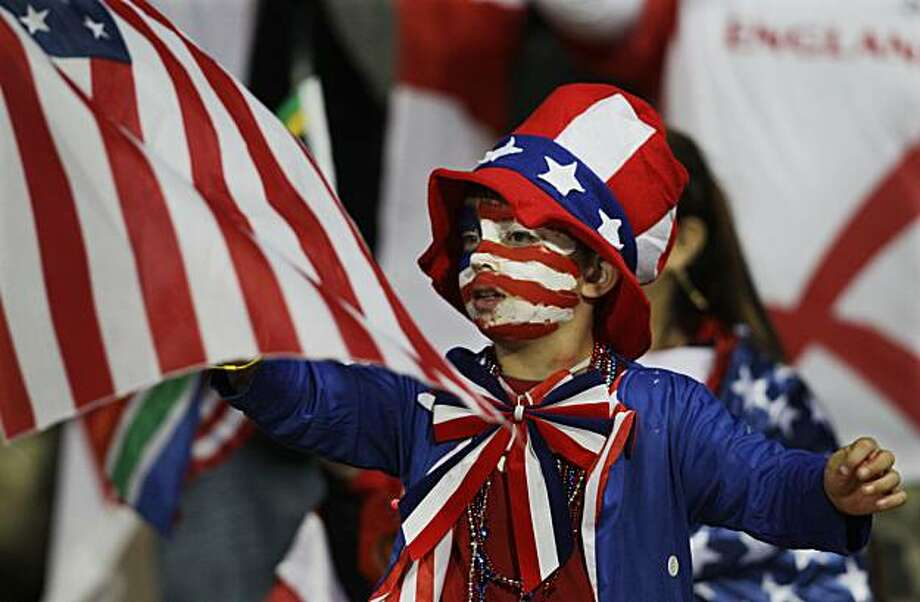 A young spectator waves an American flag before the World Cup group C soccer match between England and the United States at Royal Bafokeng Stadium in Rustenburg, South Africa, Saturday, June 12, 2010. Photo: Elise Amendola, AP