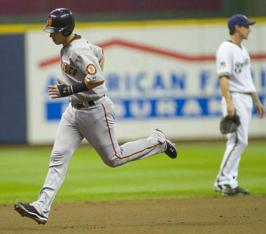 San Francisco Giants' Buster Posey, left, rounds the bases after hitting a two run home run against the Milwaukee Brewers during the first inning of a baseball game Wednesday, July 7, 2010, in Milwaukee. Photo: Darren Hauck, AP