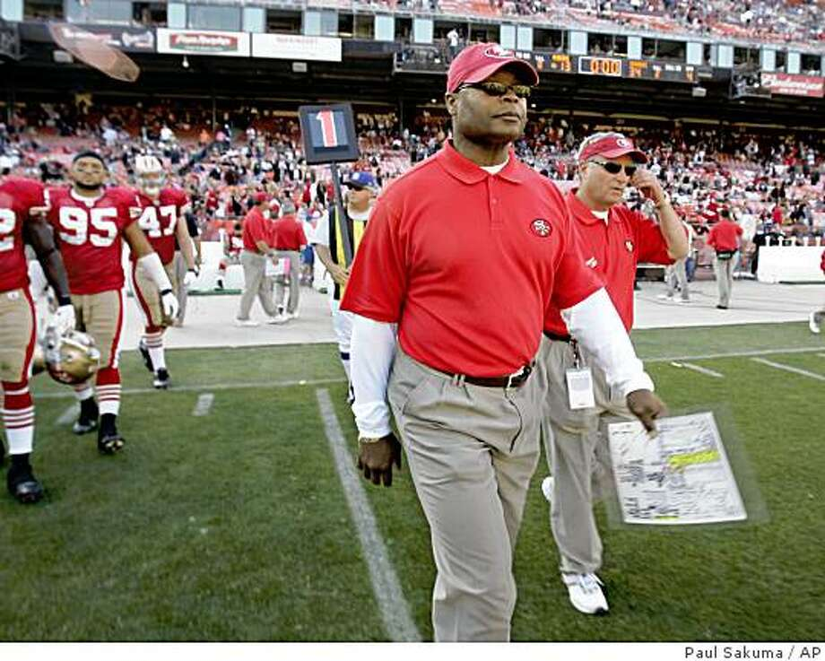 ** ADVANCE FOR WEEKEND EDITIONS, NOV. 1-2 ** FILE ** In this Oct. 26, 2008 file photo, San Francisco 49ers head coach Mike Singletary, center, walks off the field after the 49ers lost to the the Seattle Seahawks in an NFL football game in San Francisco. The 49ers have been more than bad during their five consecutive losing seasons, with a sixth almost certainly on the way. (AP Photo/Paul Sakuma, File) Photo: Paul Sakuma, AP