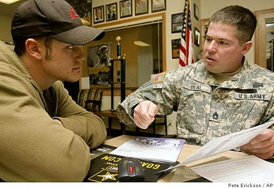 Central Oregon Community College student Lane Tucker, 19, talks with Army Sgt. 1st Class Christopher Deal on Nov. 19, 2008 in Bend, Ore.  Helped by declining violence in Iraq and an economic downturn that has driven up the Central Oregon jobless rate, Army recruiters appear now to be ahead of their recruitment goals. (AP Photo/The Bulletin, Pete Erickson) Photo: Pete Erickson, AP