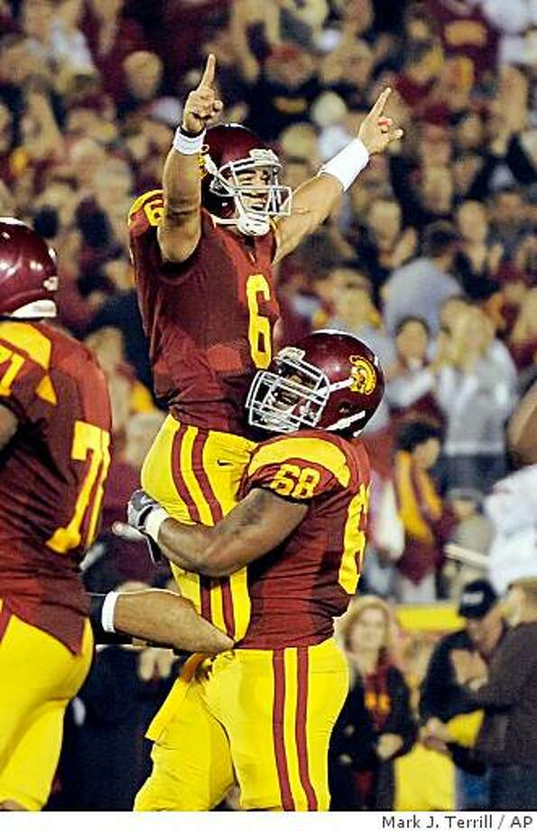 Southern California quarterback Mark Sanchez, top, celebrates a touchdown with teammate Butch Lewis during the first half of their NCAA college football game, against Notre Dame Saturday, Nov. 29, 2008, in Los Angeles.  (AP Photo/Mark J. Terrill) Photo: Mark J. Terrill, AP