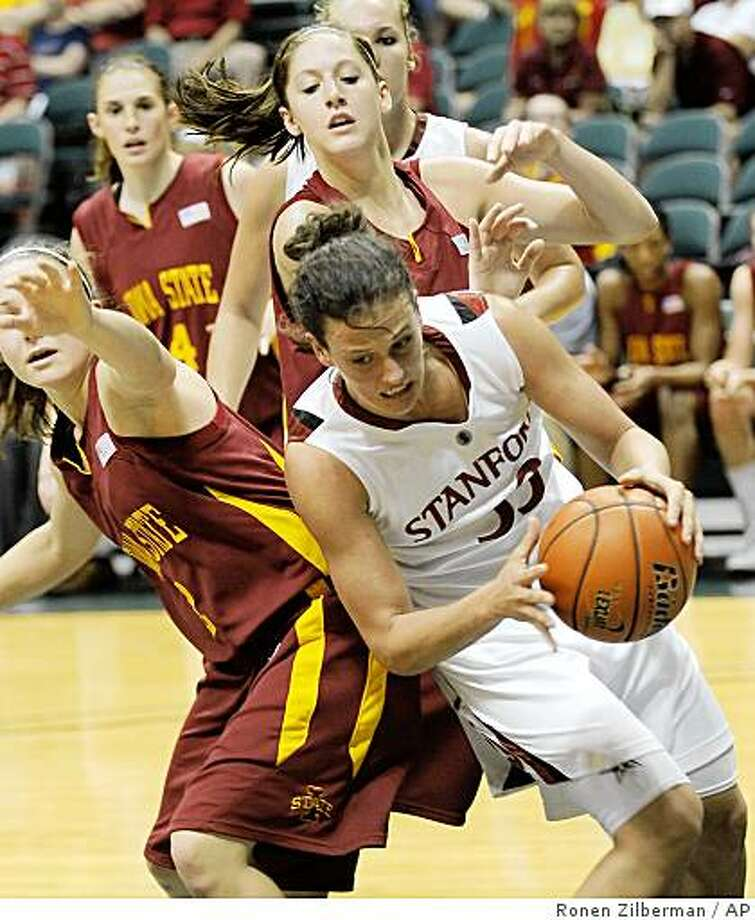 Stanford's Jillan Harmon (33) pulls the ball away from Iowa State's Whitney Williams (2) during the first half of an NCAA college basketball tournament game in Honolulu, on Saturday, Nov. 29, 2008. (AP Photo/Ronen Zilberman) Photo: Ronen Zilberman, AP