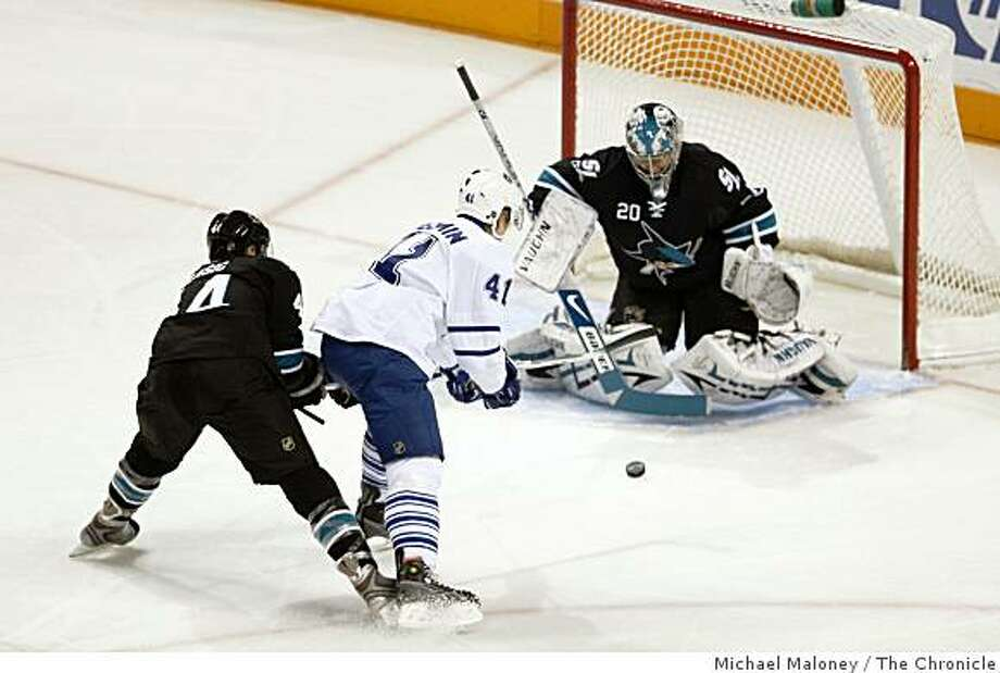 San Jose Sharks goalie Evgeni Nabokov (20) blocks a shot by Toronto Maple Leafs Nikolai Kulemin (41)�during the 1st period of a hockey game at H.P. Pavilion in San Jose, Calif., on December 2, 2008. Photo: Michael Maloney, The Chronicle