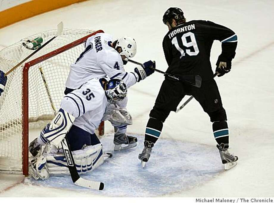 San Jose Sharks Joe Thornton (19) scores past Toronto Maple Leafs goalie Vesa Toskala (35) and Jeff Finger (4) during the 1st period of a hockey game at HP Pavilion in San Jose, Calif., on December 2, 2008. Photo: Michael Maloney, The Chronicle