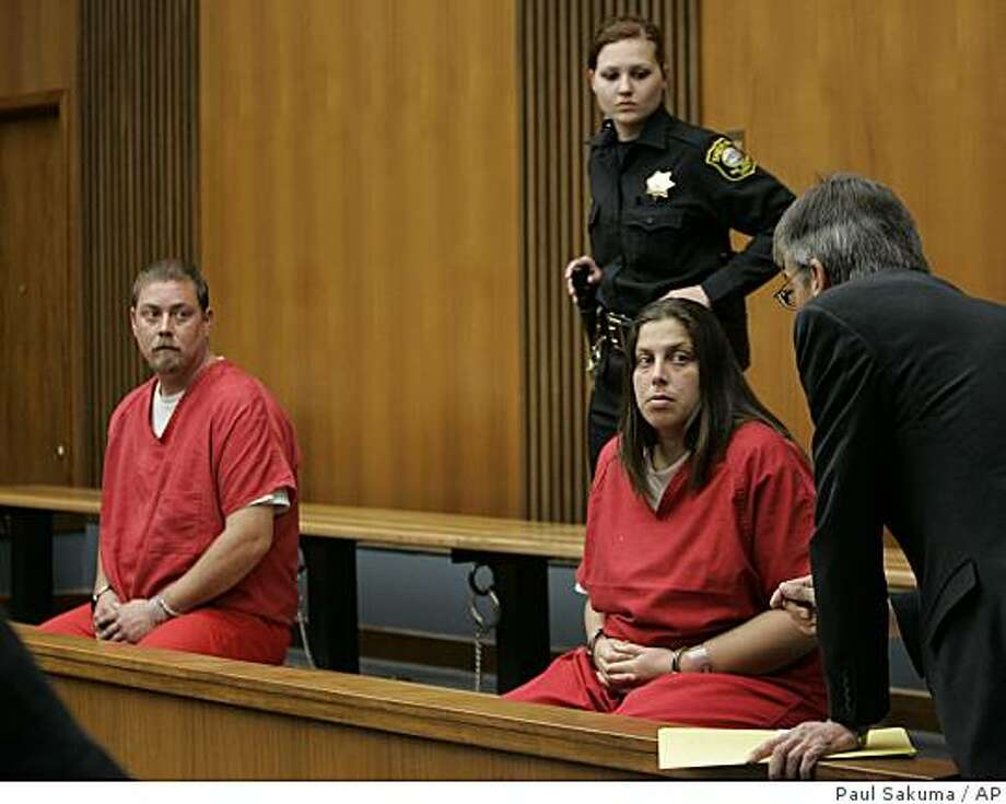 Kelly Layne Lau, 30, and her husband Michael Schumacher, 34, appear in a Stockton, Calif., courtroom on Thursday, Dec. 4, 2008. Both are charged  with kidnapping and torturing a 17-year-old boy authorities say was sometimes kept shackled inside their home.  (AP Photo/Paul Sakuma) Photo: Paul Sakuma, AP