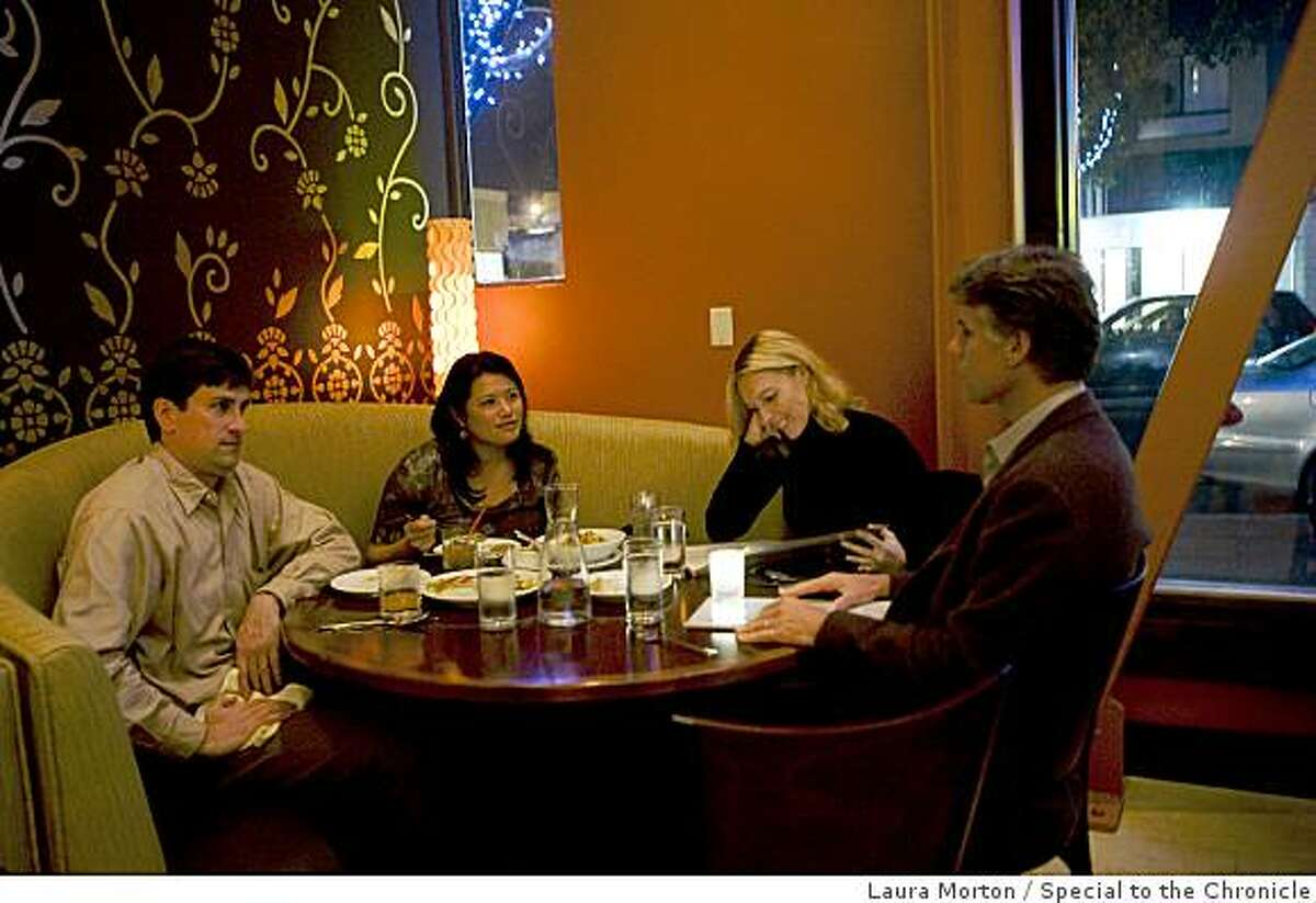 Tim Lefkowicz, Stephanie Chai, Jennifer Smorgon and Tony Smorgon (left to right) dine in one of the booths at the new location of Dosa on Fillmore Street in San Francisco , Calif., on Wednesday, November 26, 2008.