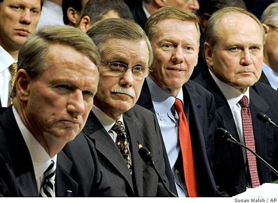 Auto executives, from left, General Motors Chief Executive Officer Richard Wagoner, UAW President Ron Gettelfinger, Ford Chief Executive Officer Alan Mulally, and Chrysler Chief Executive Officer Robert Nardelli listens to a question during a Senate Banking Committee hearing on a bailout of American automakers, Thursday, Dec. 4, 2008, on Capitol Hill in Washington. (AP Photo/Susan Walsh) Photo: Susan Walsh, AP