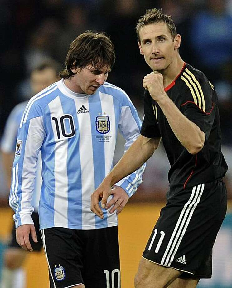 Germany's Miroslav Klose, right, walks past Argentina's Lionel Messi as he celebrates after scoring his team's fourth goal during the World Cup quarterfinal soccer match between Argentina and Germany at the Green Point stadium in Cape Town, South Africa,Saturday, July 3, 2010. Germany won 4-0. Photo: Martin Meissner, AP