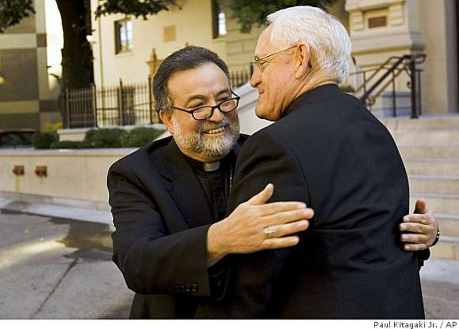 Bishop Jaime Soto, left, hugs Bishop William Weigand after being introduced as the coadjutor bishop of the Diocese of Sacramento at the Cathedral of Blessed Sacrament in Sacramento, Calif., Thursday, Oct.11, 2007. Photo: Paul Kitagaki Jr., AP